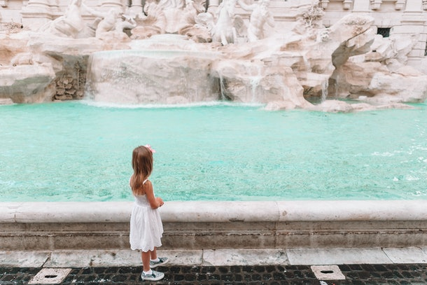 When children reach a certain age they can make wishes by throwing pennies in a fountain to make a wish like this young girl.