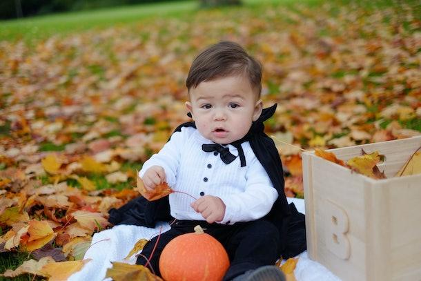 Halloween baby boy in dracula costume.
