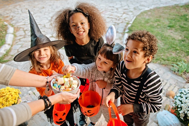 Children dressed up on Halloween, possibly hoping no one steals their candy from trick-or-treating.