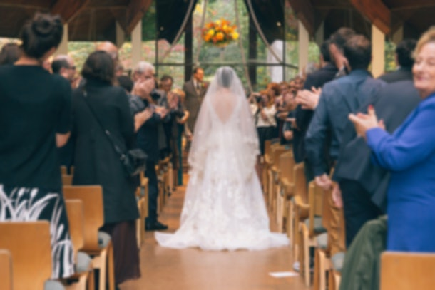 Blurred Picture of Bride Walking Down Aisle in Church