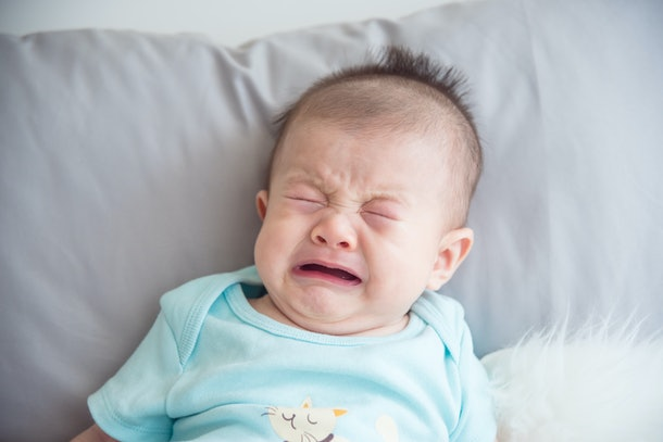Closeup shot of little asian infant crying