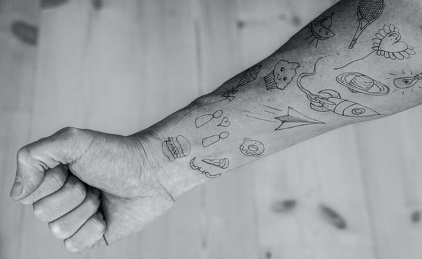 Close up of Food tattoos on forearm.