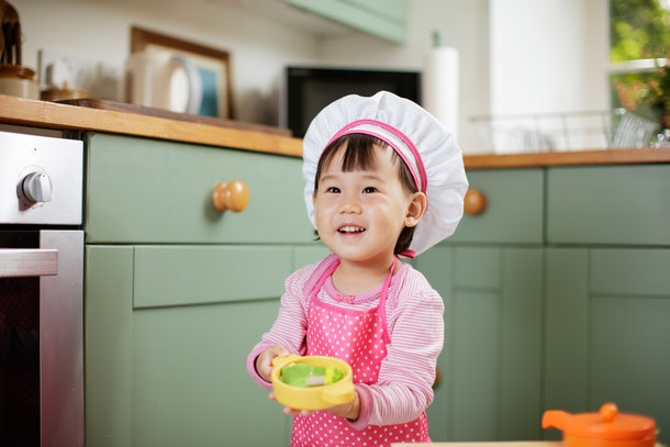 toddler baby girl pretend play baking bread