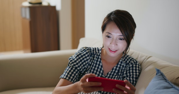 Woman watch on cellphone at home