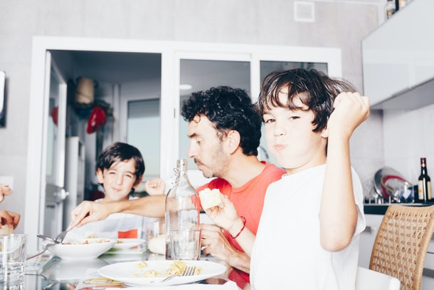 happy family enjoying meal at the kitchen