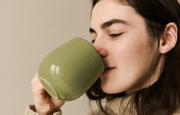 Woman drinks tea from a cup