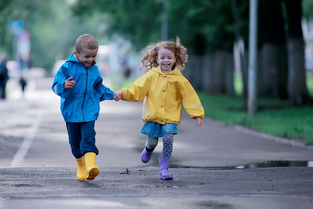 Experts say playing outside really benefits a child's development, even in bad weather.