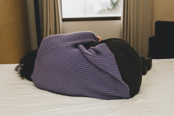 Woman depressed on the bed