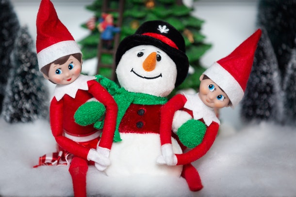 Elf on the shelf with a snowman.