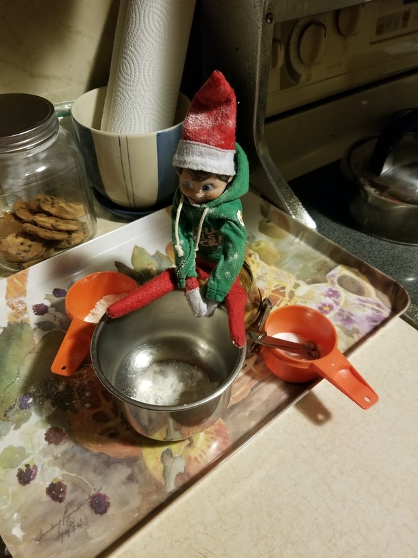 Elf on a shelf making sugar cookied