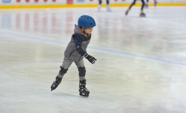 No matter where you ice skate, experts suggest putting your child in safety equipment like a helmet and knee pads.