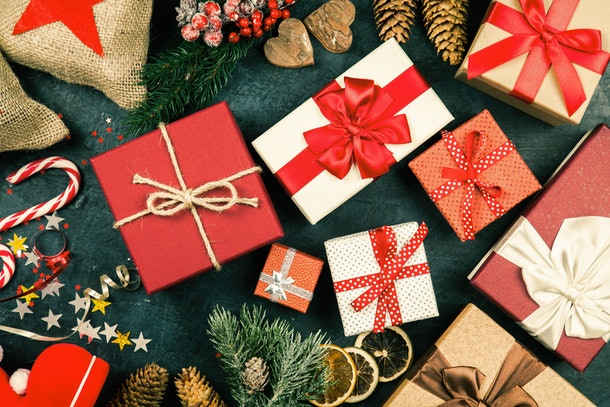pile of Christmas presents on dark background
