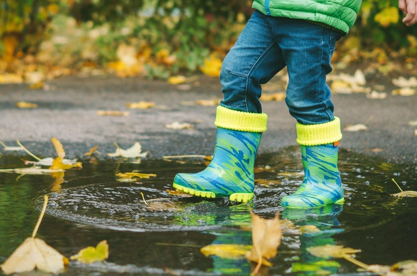 Rain boots open up a world of play and exploration for your child, experts say.