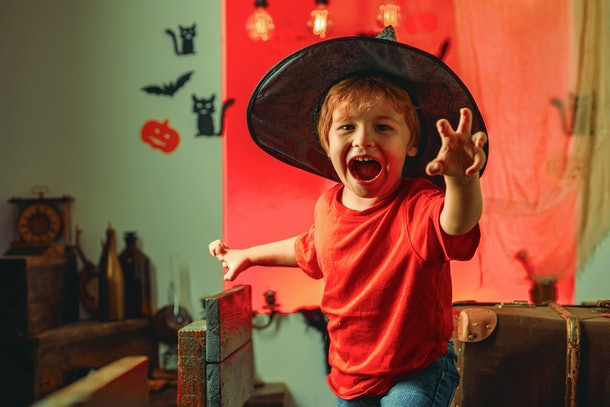 Horror face. Secrets of Magic for Happy Halloween. Halloween kids party and funny Pumpkin. Funny boy