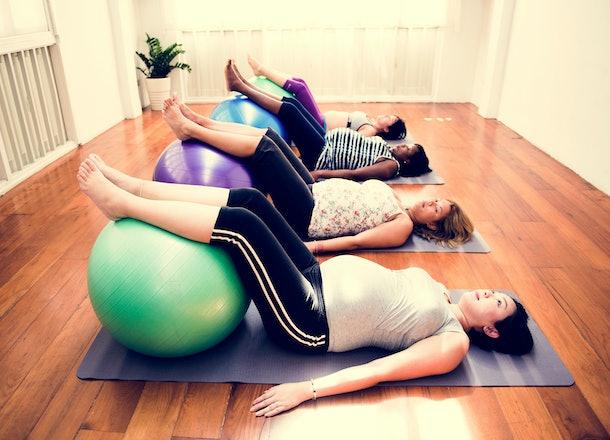 Pregnant woman in yoga class