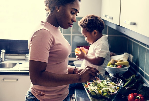 Black kid with mom in the kitchen