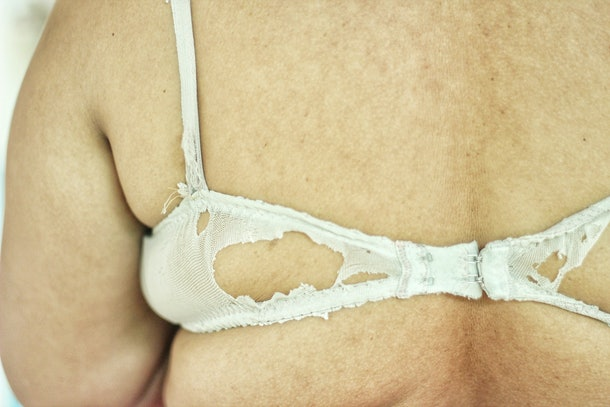 The back of a fat woman, a fat woman wearing an old bra, Women's old underwear