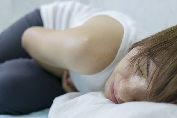Asian women pelvic pain.Focus on face women are menstruating.