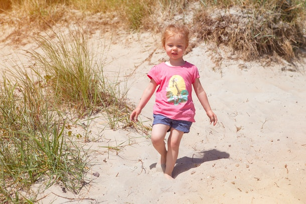 little  girl l at the beach having fun