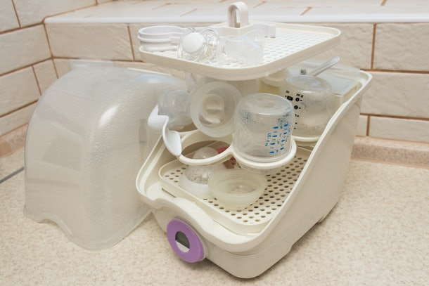 Close-up of baby bottle sterilizer. Used to disinfect bottles, manual breast pump, bottle nipples, teethers and other baby feeding items. Using the steam to kill the harmful household germs