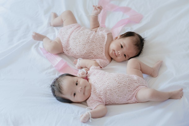 Twin babies on the bed