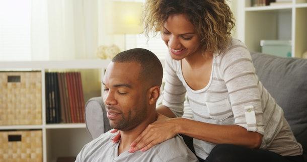 Black girlfriend giving boyfriend massage