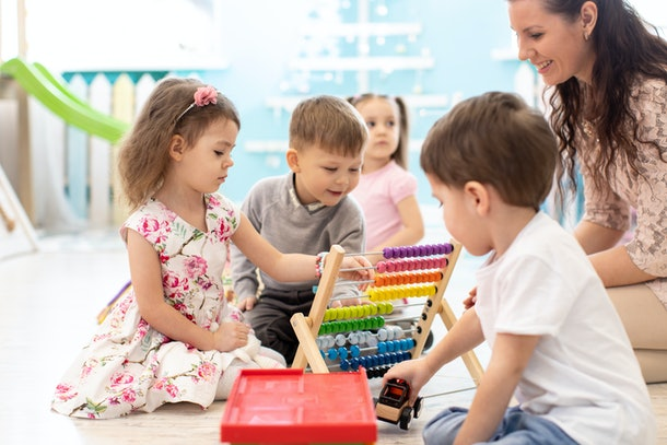Experts say children can still spread COVID-19 at day care, even if they aren't showing symptoms.